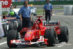 Race winner Michael Schumacher arrives in Parc Fermé