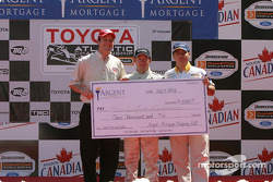 Podium: race winner Jon Fogarty accepts a check