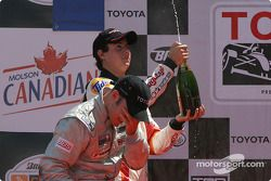 Podium: champagne for Jon Fogarty and Andrew Ranger