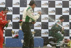 Podium : douche de champagne pour Tomy Drissi, Tommy Kendall et Garrett Kletjian, pendant que Paul Gentilozzi est sur le sol
