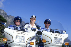 Jenson Button ve members, local police force