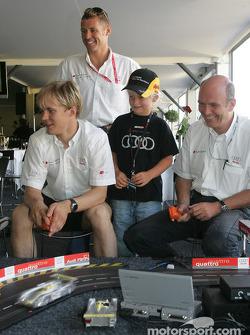 Mattias Ekström, Tom Kristensen and Dr Wolfgang Ullrich have fun with the Audi slotcar track