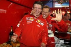 Michael Schumacher celebrates with Ross Brawn