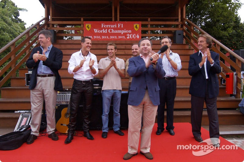 Jean Todt on stage, with Ross Brawn, Michael Schumacher, Luca Badoer, Rubens Barrichello, Paolo Mart