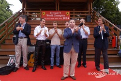 Jean Todt on stage, with Ross Brawn, Michael Schumacher, Luca Badoer, Rubens Barrichello, Paolo Mart