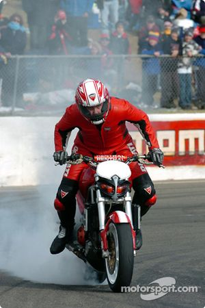 Stunt rider Paul Bates performs for the crowd