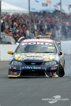 Paul Radisich pits with suspension damagae