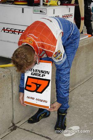 Shane Lewis prepares the sign