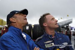 John Gorsline and David Donohue watch the reply of turn 11