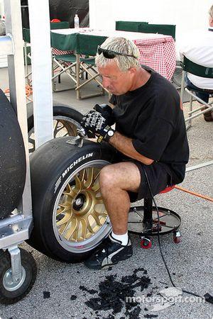 Crew member scrubs tires