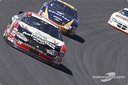 Greg Biffle putting a lap on Mike Bliss