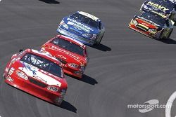 Martin Truex Jr. leads the pack coming though turn 4