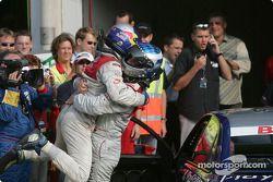 Race winner Mattias Ekström celebrates with Martin Tomczyk