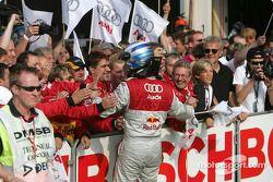 Martin Tomczyk celebrates podium finish with his team