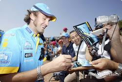 Franck Montagny signs autographs