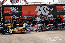 Angelle Savoie, Craig Treble, GT Tonglet, and Michael Philips pose with their crews prior to the K&N Pro Bike Klash