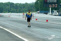 Greg Anderson inspect the concert-asphalt transition and he isn't happy about what he sees