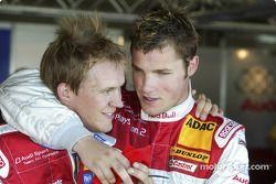 Mattias Ekström celebrates pole position with Martin Tomczyk