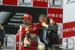 Podium: champagne for Rubens Barrichello and Luca di Montezemelo
