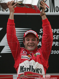 Podium: race winner Rubens Barrichello celebrates