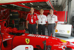 Bridgestone team members pose in Ferrari garage