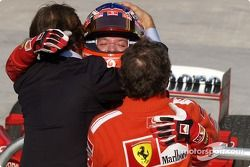 Race winner Rubens Barrichello celebrates with Luca di Montezemelo and Jean Todt