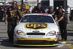 Robert Yates Racing crew push the UPS car in garage area