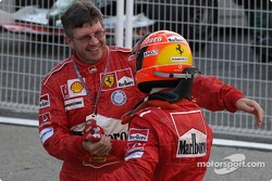 Race winner Michael Schumacher celebrates with Ross Brawn