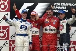 Podium: race winner Michael Schumacher with Ralf Schumacher, Ross Brawn and Jenson Button