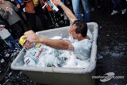 Bernd Schneider celebrates in a bath