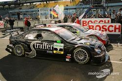 Bernd Schneider and Gary Paffett's Mercedes AMG