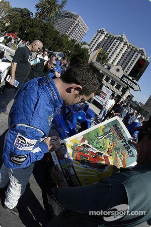 The Sixth Annual Mini Le Mans of San Jose: Nicolas Minassian signs an autograph