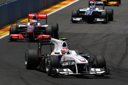 Kamui Kobayashi, BMW Sauber F1 Team leads Jenson Button, McLaren Mercedes