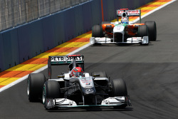 Michael Schumacher, Mercedes GP leads Adrian Sutil, Force India F1 Team