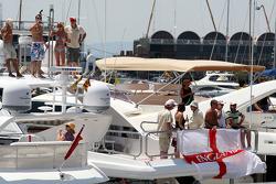 Race fans on boats