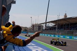 Marcus Ericsson crosses the line to take victory