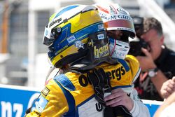 Marcus Ericsson celebrates his victory with Giedo Van der Garde