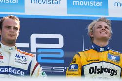 Marcus Ericsson celebrates his victory on the podium with Giedo Van der Garde