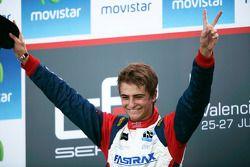 Nico Muller celebrates victory on the podium