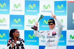 Roberto Merhi celebrates on the podium