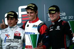 Nico Muller celebrates victory on the podium with Roberto Merhi and James Jakes