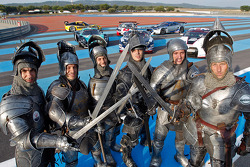 Christophe Bouchut, Frédéric Makowiecki, Marc Hennerici, Thomas Mutsch, Michael Krumm and Andrea Bertolini stage a mock medieval fight on track for the cameras