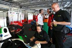 Engineers work on the car of Mihai Marinescu