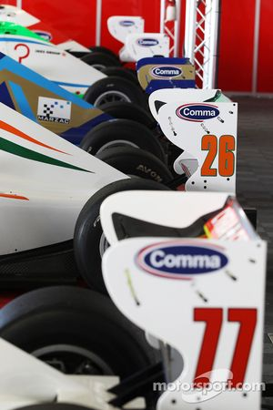 Formula Two cars in the pit garage