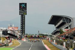 Start: Dani Pedrosa, Repsol Honda Team and Jorge Lorenzo, Fiat Yamaha Team battle for the lead