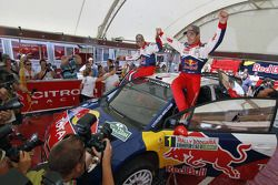 Winners Sébastien Loeb and Daniel Elena celebrate with Citroën Total World Rally team members