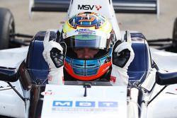 Dean Stoneman celebrates Pole Position in Parc Ferme