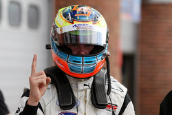 Dean Stoneman celebrates Pole Position in Parc Ferme