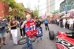 Party on John Street: Alex Tagliani, FAZZT Race Team and Paul Tracy, KV Racing Technology trade hockey jersey