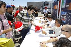 Autograph session: Giancarlo Fisichella and Jean Alesi